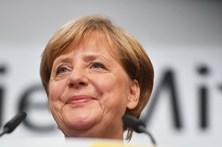 Merkel vence eleições na Alemanha, sem maioria