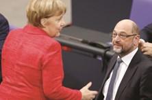 SPD sob pressão para apoiar Merkel