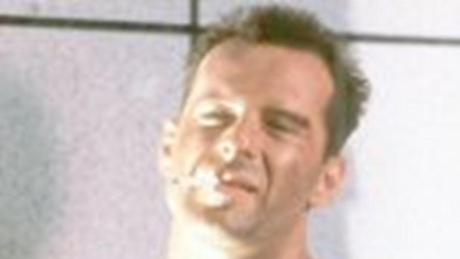 Bruce Willis em 1988 quando se estreou como John McClane