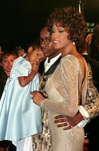 Whitney numa foto de família, com o marido Bobby Brown e a filha Bobbi Kristina. (Reuters)