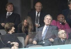 George W. Bush, antigo presidente dos EUA, e a sua mulher, Laura