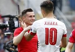 O reencontro de irmão durante a partida entre Albânia e Suíça
