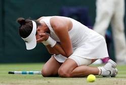 Muguruza comemora vitória em Wimbledon