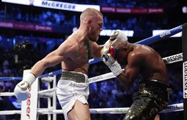 Mayweather e McGregor no combate