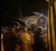 Avião parte-se em dois ao aterrar na Índia no meio de tempestade com 190 passageiros a bordo