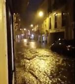 Rua no centro de Lisboa inundada