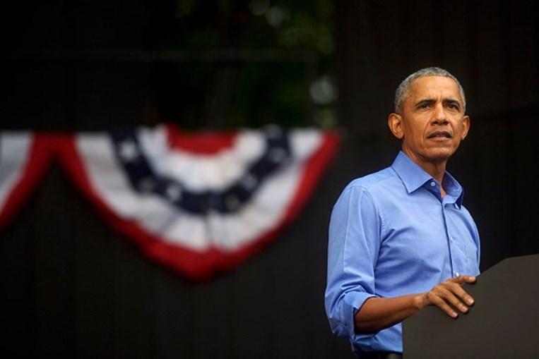 'Podemos sair deste buraco': Obama ataca Trump em discurso de campanha por Joe Biden perante uma 'plateia' de carros