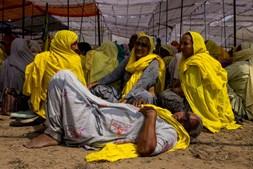 Agricultoras protestam contra as leis agrícolas indianas no Dia Internacional da Mulher em Bahadurgarh, na Índia