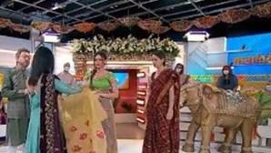 Como se coloca um Sari, traje nacional das mulheres indianas