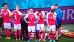 Jogador da Dinamarca colapsa no relvado durante jogo com a Finlândia. Está a ser alvo de manobras de reanimação